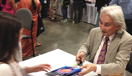 Dr. Kaku signs copies of his latest book for a crowd of fans at a recent book fair.